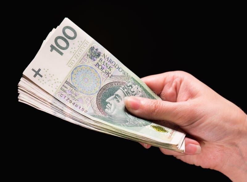 Θηλυκό χέρι με τα χρήματα στοκ φωτογραφία