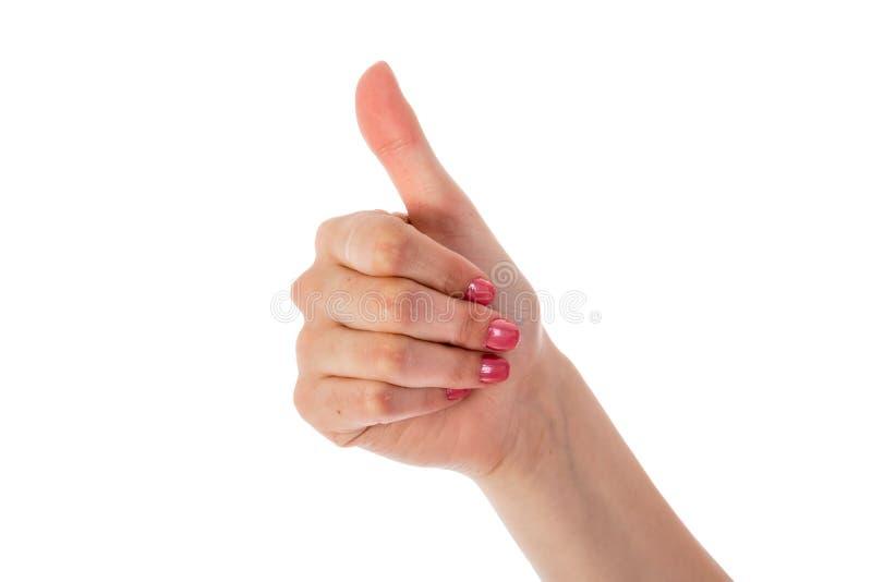 Θηλυκό χέρι που παρουσιάζει αντίχειρα στοκ εικόνες