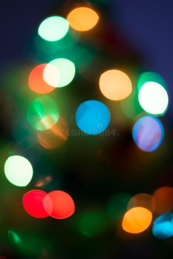 Θολωμένο περίληψη φως με το σκούρο μπλε υπόβαθρο στοκ εικόνα