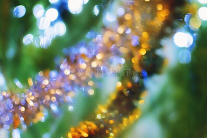 Θολωμένο πολύχρωμο υπόβαθρο Χριστουγέννων με το bokeh στοκ εικόνες