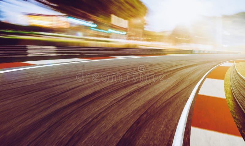 Θολωμένη κίνηση πίστα αγώνων, σκηνή ηλιοβασιλέματος στοκ εικόνες