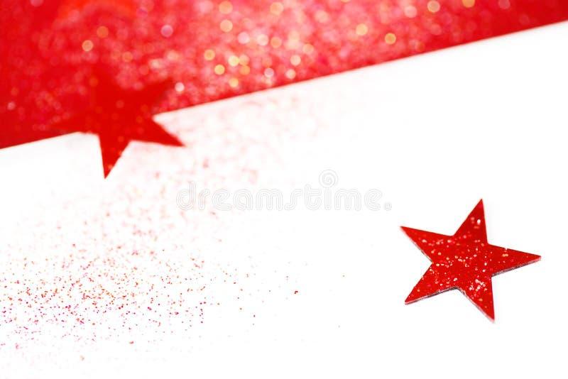 Θολωμένο υπόβαθρο Χριστουγέννων με τα αστέρια στοκ εικόνα