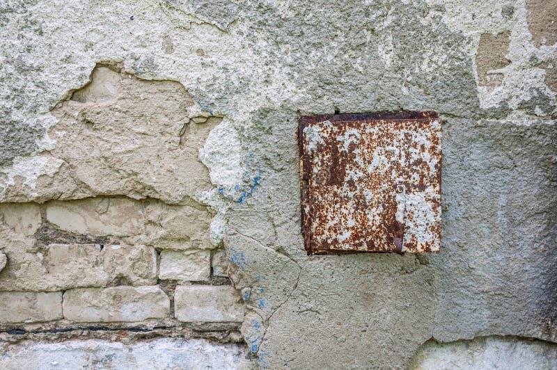 Θρυμματισμένος από το συγκεκριμένο σκηνικό υποβάθρου ταπετσαριών τουβλότοιχος στόκων στοκ φωτογραφία