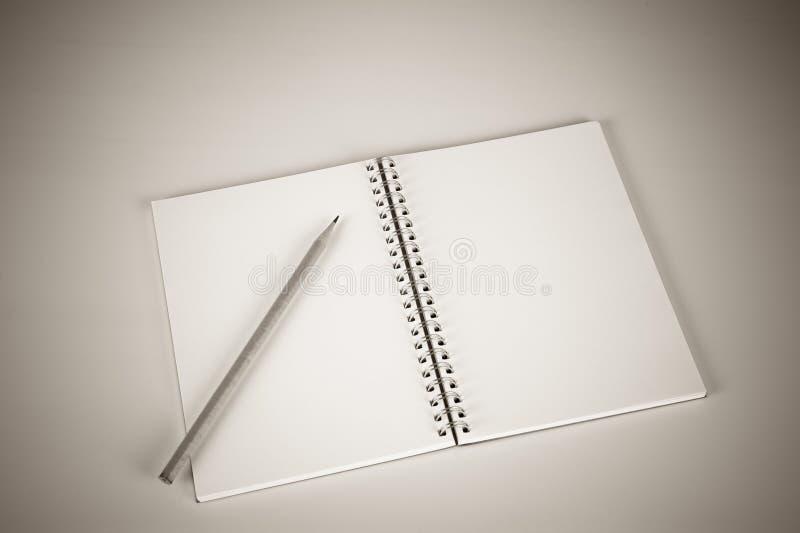 διαθέσιμο μολύβι σημειωματάριων απεικόνισης στοκ εικόνες