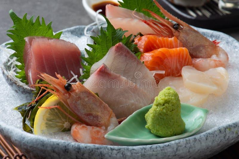 ιαπωνικό sashimi τροφίμων (ακατέργαστα τεμαχισμένα ψάρια, οστρακόδερμα ή καρκινοειδής στοκ εικόνες με δικαίωμα ελεύθερης χρήσης