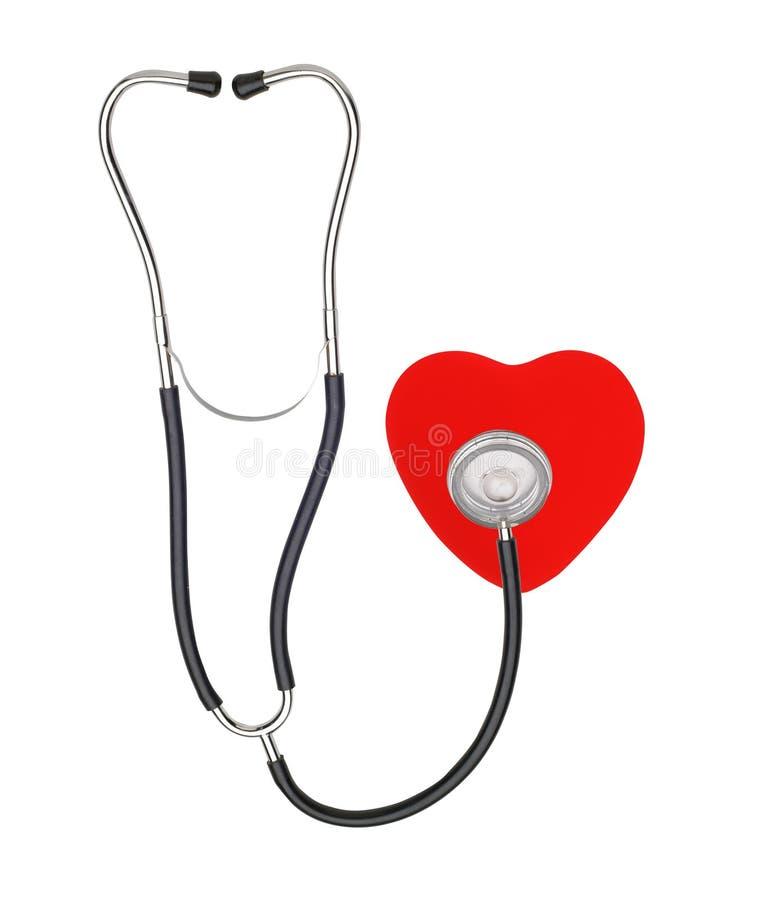 Ιατρικές στηθοσκόπιο και καρδιά που απομονώνονται στο λευκό στοκ φωτογραφία