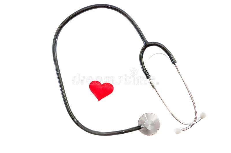 Ιατρικό στηθοσκόπιο και κόκκινη καρδιά που απομονώνονται στο άσπρο υπόβαθρο στοκ εικόνες