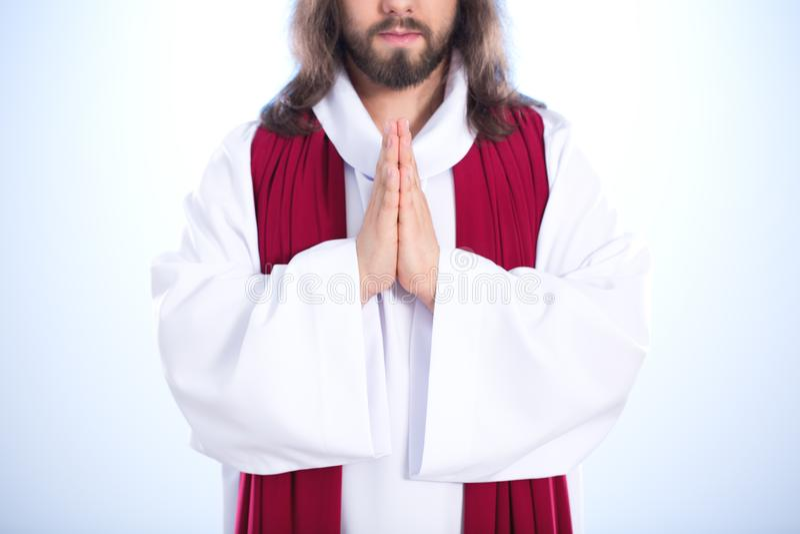 Ιησούς με τα διπλωμένα χέρια στοκ εικόνες
