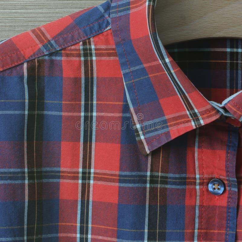 Ιματισμός ατόμων Κομμάτι του πουκάμισου καρό στοκ εικόνα
