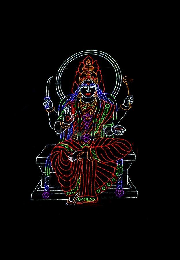 Ινδή θεά που επιδεικνύεται σωρηδόν των φω'των των ζωηρόχρωμων οδηγήσεων
