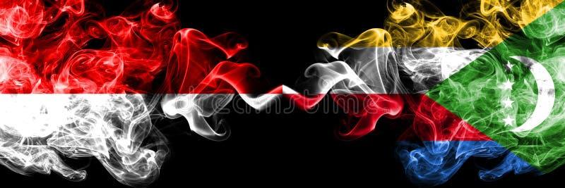 Ινδονησία εναντίον των Κομορών, από τις Κομόρες καπνώείς απόκρυφες σημαίες που τοποθετούνται δίπλα-δίπλα Πυκνά χρωματισμένες μετα απεικόνιση αποθεμάτων