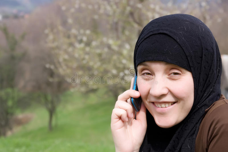 ισλαμική κινητή ομιλούσα &g στοκ εικόνα