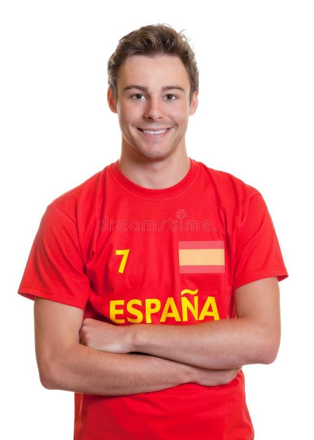 Ισπανικός ανεμιστήρας ποδοσφαίρου με τα διασχισμένα όπλα στοκ εικόνες