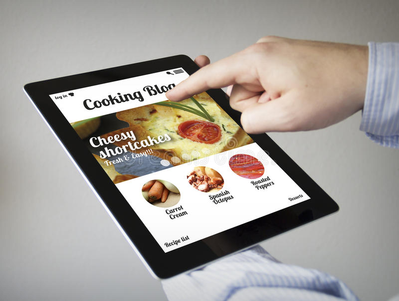 Ιστοχώρος μαγειρέματος σε μια ταμπλέτα στοκ εικόνες