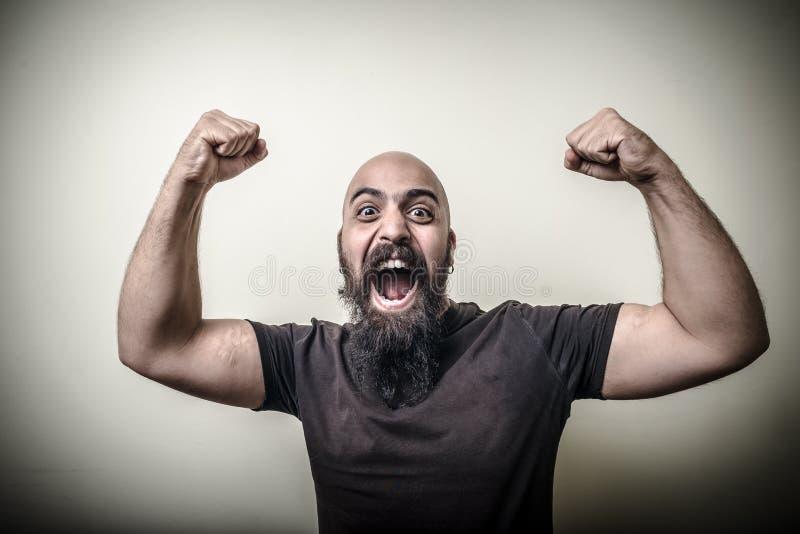 Ισχυρό γενειοφόρο άτομο νικητών στοκ φωτογραφία