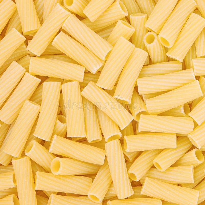 Ιταλική Macaroni ανασκόπηση τροφίμων ζυμαρικών ακατέργαστη στοκ εικόνα