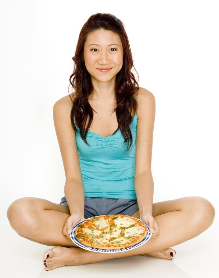 Κάθισμα με την πίτσα στοκ φωτογραφίες με δικαίωμα ελεύθερης χρήσης