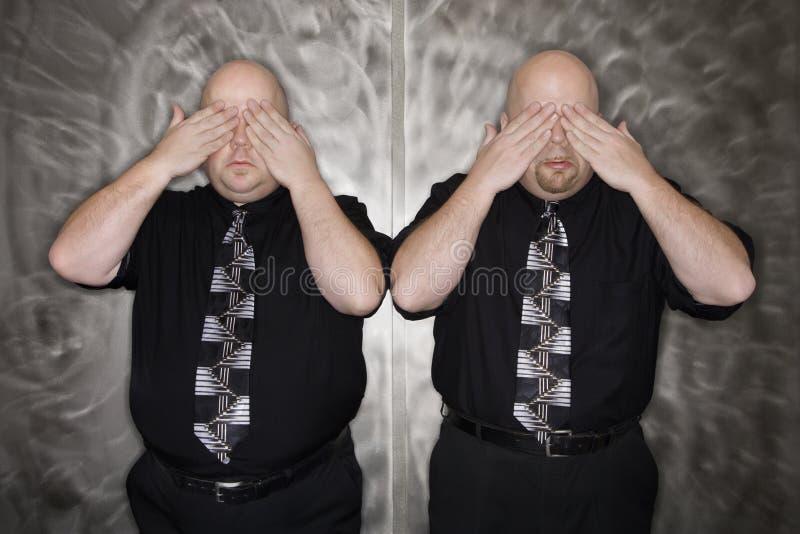 κάλυψη του διδύμου ατόμων ματιών στοκ εικόνα