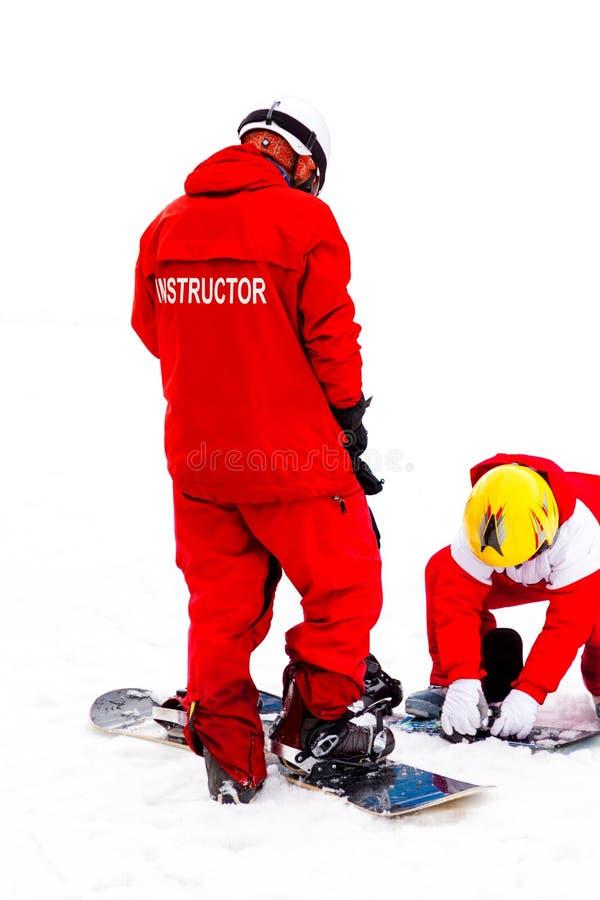 Κάνοντας σκι εκπαιδευτικός και ένα παιδί στοκ εικόνες