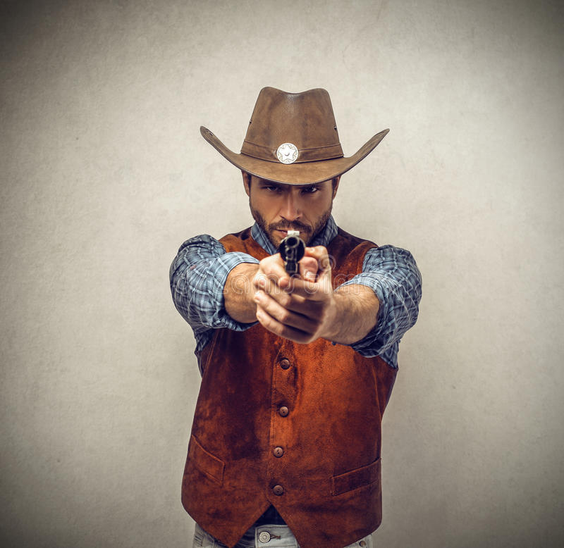 Κάουμποϋ με ένα πυροβόλο όπλο στοκ εικόνα με δικαίωμα ελεύθερης χρήσης