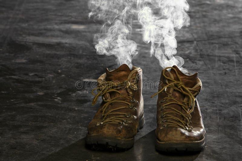 κάπνισμα μποτών στοκ εικόνα