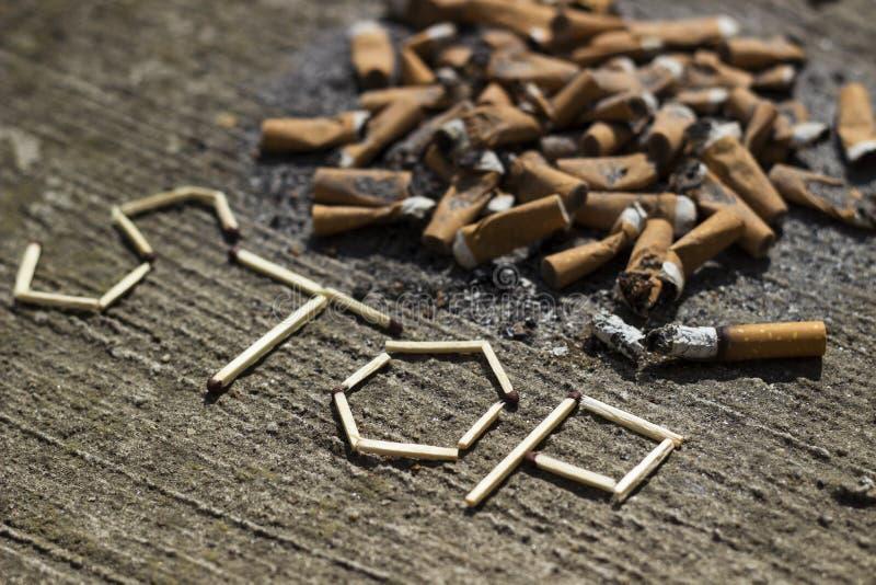 Κάπνισμα στάσεων στοκ εικόνα