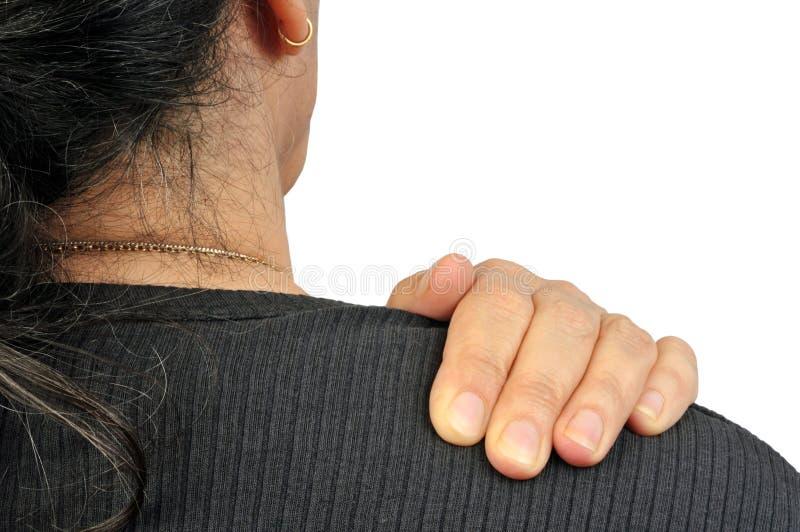 Κάποιος με τον πόνο ώμων στοκ φωτογραφίες