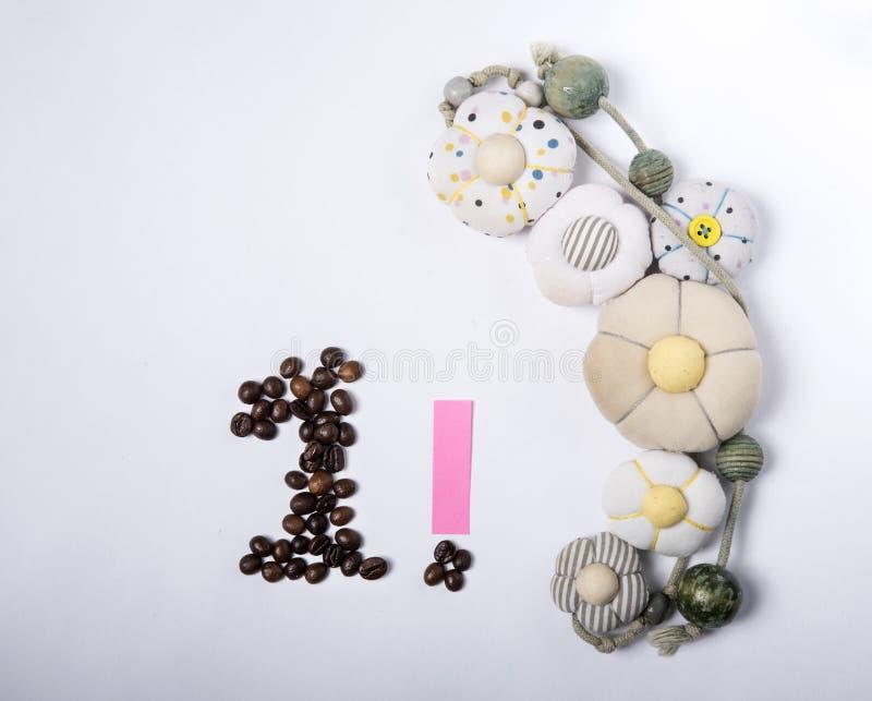 Κάρτα διακοπών - αριθμός 1 ψημένων φασολιών καφέ στοκ εικόνες