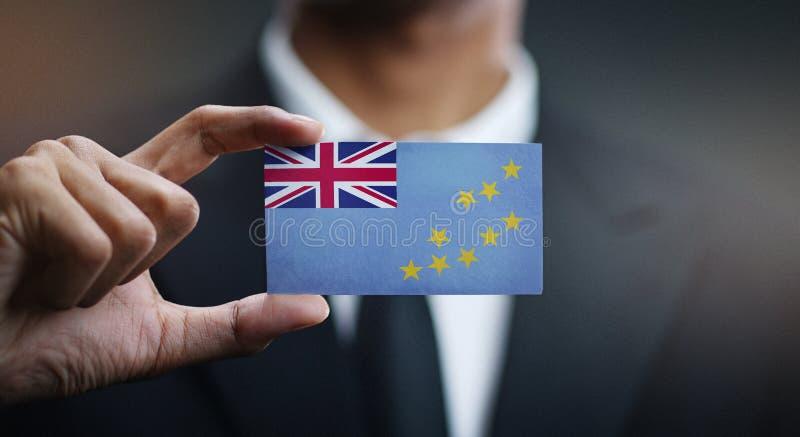 Κάρτα εκμετάλλευσης επιχειρηματιών της σημαίας του Τουβαλού στοκ εικόνες