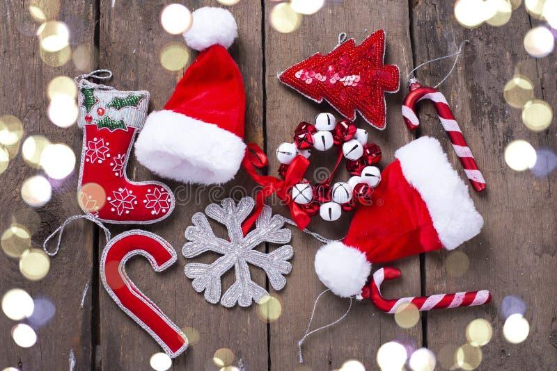 Κάλαμος καραμελών διακοσμήσεων Χριστουγέννων, δέντρο, snowflake, καπέλο Santa στοκ φωτογραφίες