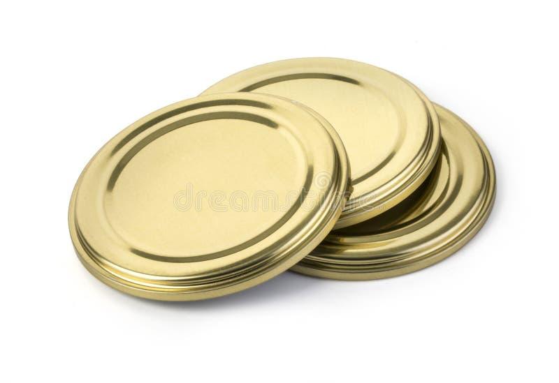 Κάλυψη μετάλλων για το κλείσιμο των βάζων γυαλιού στοκ εικόνα