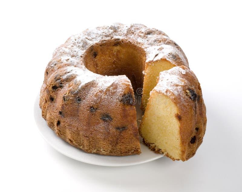 Κέικ με τη σταφίδα και ζάχαρη στο πιάτο στοκ εικόνες