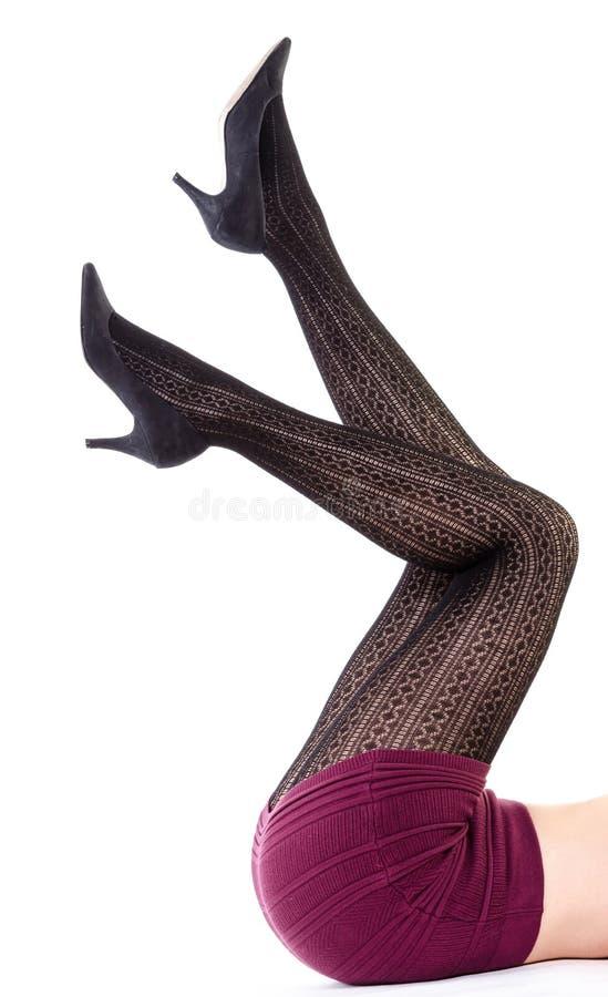 Κίνηση επάνω στα προκλητικά πόδια γυναικών στοκ εικόνες