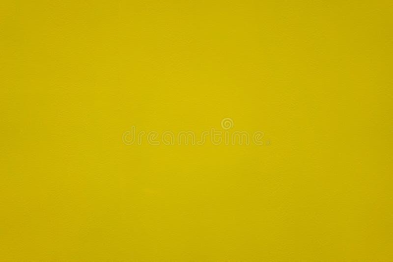 Κίτρινη επιφάνεια, τραχιά επιφάνεια στον τοίχο τραχύ στοκ εικόνα