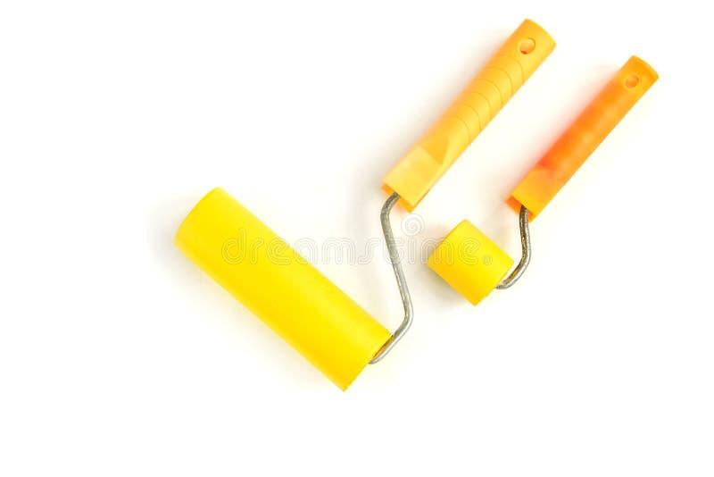 Κίτρινος κύλινδρος την ταπετσαρία που απομονώνεται για στο λευκό στοκ φωτογραφίες