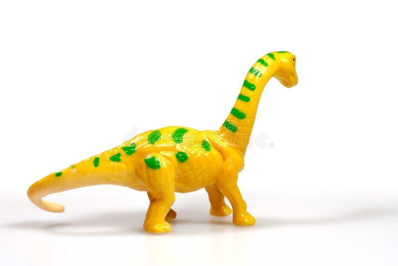 Κίτρινος πλαστικός δεινόσαυρος στοκ φωτογραφία με δικαίωμα ελεύθερης χρήσης