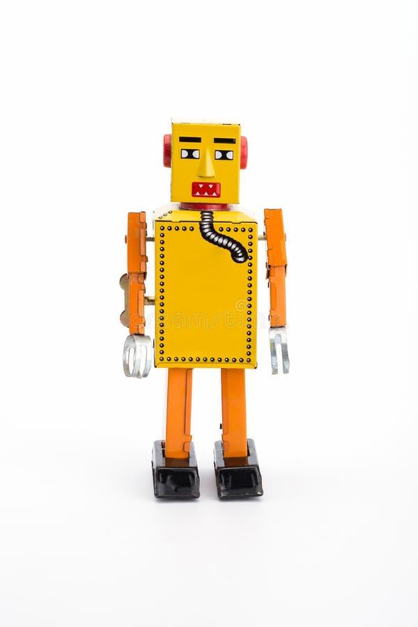 Κίτρινο αναδρομικό ρομπότ παιχνιδιών στοκ φωτογραφίες με δικαίωμα ελεύθερης χρήσης