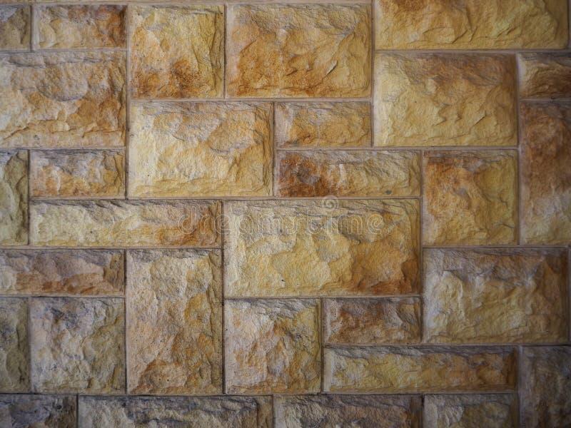 Κίτρινο αφηρημένο υπόβαθρο τοίχων πετρών στοκ φωτογραφίες