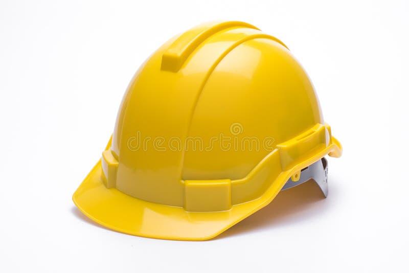 Κίτρινο κράνος ασφάλειας που απομονώνεται στο άσπρο υπόβαθρο στοκ φωτογραφίες
