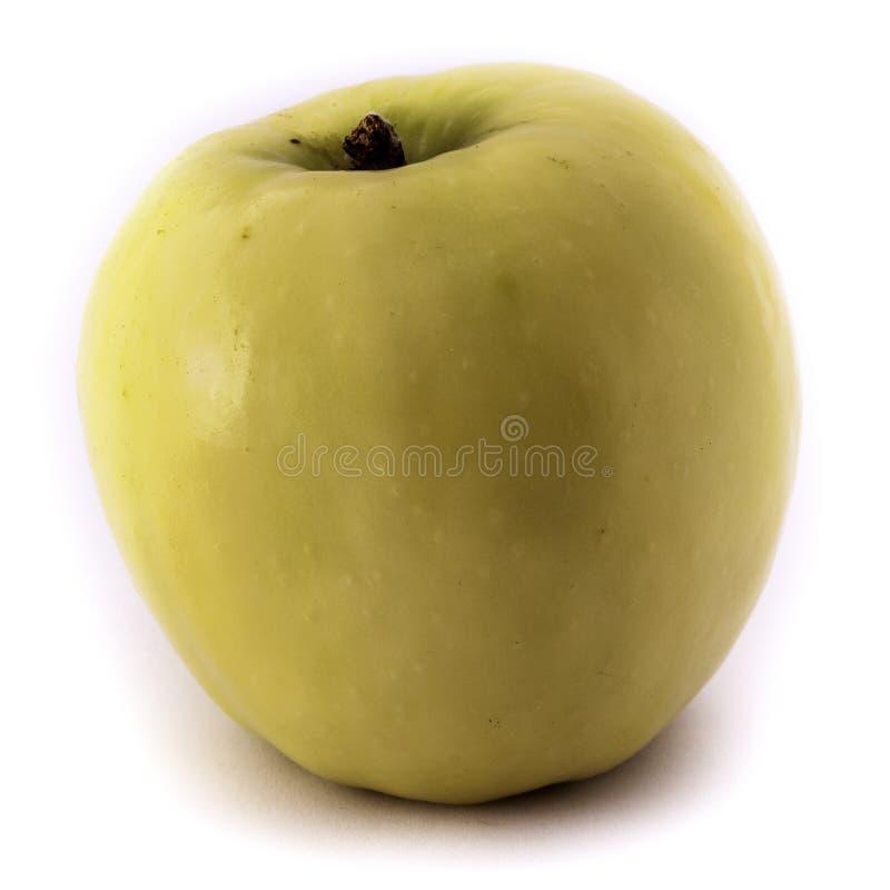 Κίτρινο μήλο στην άσπρη ανασκόπηση στοκ φωτογραφίες με δικαίωμα ελεύθερης χρήσης
