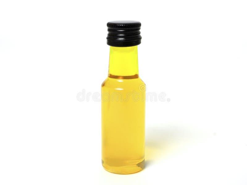 Κίτρινο μπουκάλι στο άσπρο υπόβαθρο στοκ εικόνες