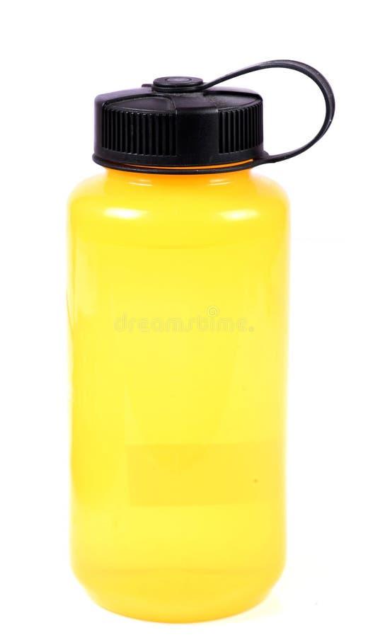 Κίτρινο μπουκάλι νερό στοκ εικόνες