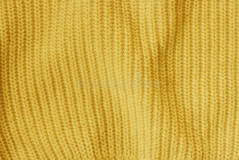 Κίτρινο πλεκτό μάλλινο υπόβαθρο σχεδίων υφάσματος στοκ φωτογραφία με δικαίωμα ελεύθερης χρήσης