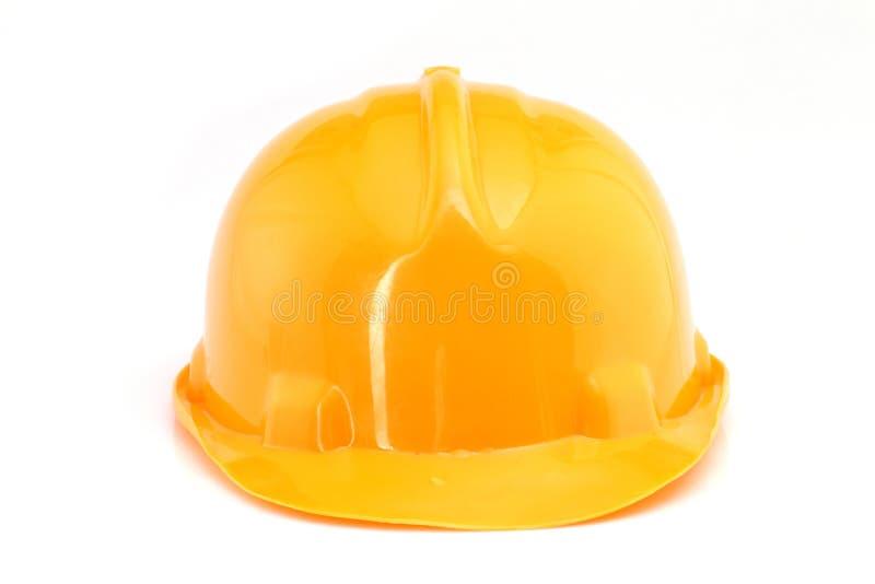 Κίτρινο σκληρό καπέλο στο λευκό στοκ φωτογραφίες