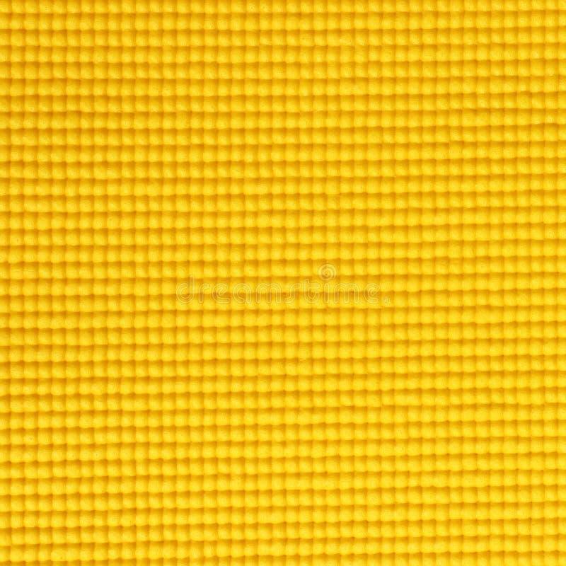 Κίτρινο υπόβαθρο σύστασης χαλιών γιόγκας χρώματος στοκ εικόνες με δικαίωμα ελεύθερης χρήσης