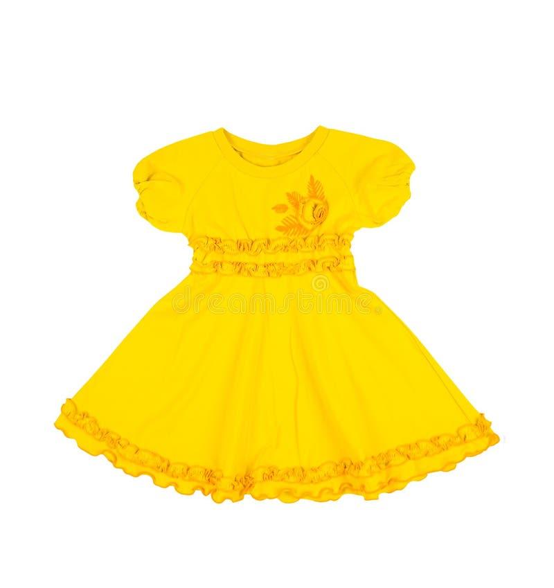 Κίτρινο φόρεμα μωρών που απομονώνεται στο άσπρο υπόβαθρο στοκ φωτογραφίες