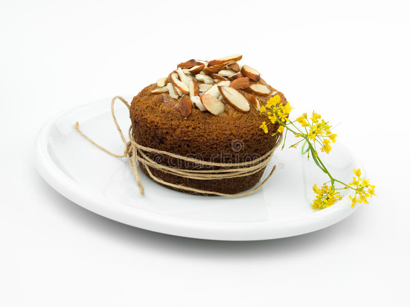 Κίτρινο muffin αμυγδάλων λουλουδιών στοκ εικόνα