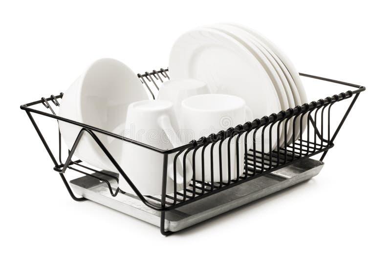 Καθαρά πιάτα που ξεραίνουν στο ράφι πιάτων μετάλλων στοκ εικόνα με δικαίωμα ελεύθερης χρήσης