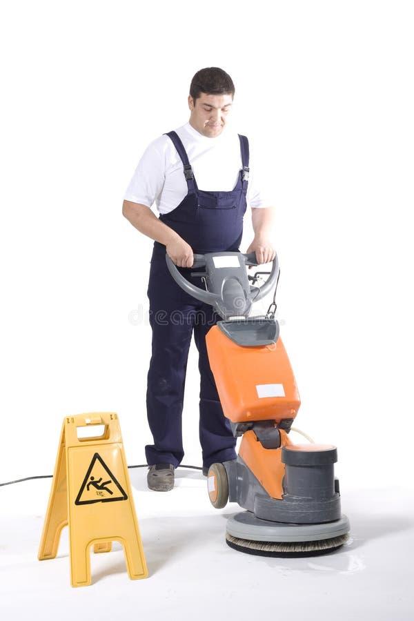 Καθαρίζοντας πάτωμα με τη μηχανή στοκ φωτογραφία