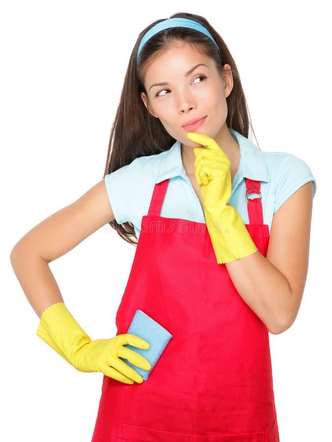 καθαρίζοντας σκεπτόμενη γυναίκα στοκ φωτογραφίες